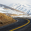 Road Through A Snowy Mountain Landscape by Thom Gourley/Flatbread Images, LLC
