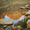 Rocky Mountain Peaks Are Reflected by Gordon Wiltsie