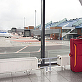 Rolling Luggage In An Airport Concourse by Jaak Nilson