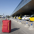 Rolling Luggage Outside An Airport Terminal by Jaak Nilson
