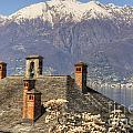 Roof With Chimney And Snow-capped Mountain by Mats Silvan