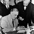 Roosevelt Signing Declaration Of War by Photo Researchers