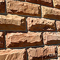 Rough Hewn Sandstone Brick Wall Of A Historic Building by Gary Whitton