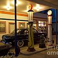 Route 66 Garage At Night by Bob Christopher