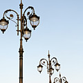 Row Of Fancy Street Lamps by Travelif
