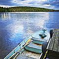 Rowboat Docked On Lake by Elena Elisseeva