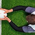Rugby Player Scoring A Try With Both Hands. by Richard Thomas