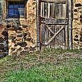 Rustic Wooden Door In Stone Barn by Jill Battaglia
