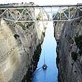 Sailboat IIi Sailing Thru Corinth Canal Waters In Greece by John Shiron