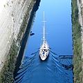 Sailboat Sailing Thru Corinth Canal Waters In Greece by John Shiron