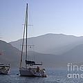 Sailing Boats At Dawn In Karacaoren Bay by Louise Heusinkveld
