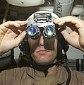 Sailor Adjusts His Anavs-9 Night Vision by Stocktrek Images