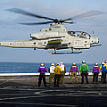 Sailors And Marines Watch An Ah-1z by Stocktrek Images