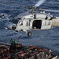 Sailors Attach Pallets Of Supplies by Stocktrek Images