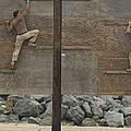 Sailors Crawl Across Narrow Planks by Stocktrek Images