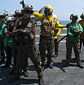 Sailors Fight A Simulated Fire Drill by Stocktrek Images
