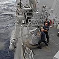 Sailors Fire A Mark 38 Machine Gun by Stocktrek Images