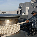 Sailors Handle Mooring Lines Aboard Uss by Stocktrek Images