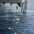 Sailors Jump To The Sea During A Swim by Stocktrek Images