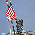 Sailors Lower The National Ensign by Stocktrek Images