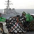Sailors Move Supplies On The Flight by Stocktrek Images