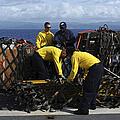 Sailors Prepare Pallets Of Cargo Aboard by Stocktrek Images