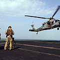Sailors Prepare To Board An Mh-60s Sea by Stocktrek Images