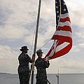 Sailors Raise The American Flag Aboard by Stocktrek Images