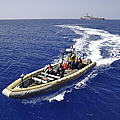Sailors Transit An Inflatable Boat by Stocktrek Images