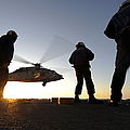 Sailors Watch A Helicopter Lift by Stocktrek Images