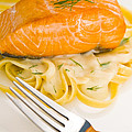 Salmon Steak On Pasta Decorated With Dill by U Schade