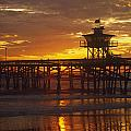 San Clemente Lifeguard Tower And Pier At Sunset by Cliff Wassmann