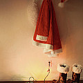 Santa Costume Hanging On Coat Hook With Christmas Lights by Sandra Cunningham