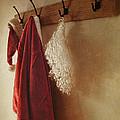 Santa Costume Hanging On Coat Rack by Sandra Cunningham