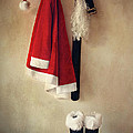 Santa Costume With Boots On Coathook by Sandra Cunningham