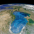 Satellite View Of Swirling Blue by Stocktrek Images