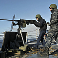 Seaman Fires A .50 Caliber Machine Gun by Stocktrek Images