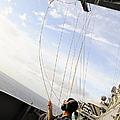 Seaman Raises The Foxtrot Flag by Stocktrek Images
