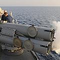 Seamen Fire An Air Slug From A Mk-32 by Stocktrek Images