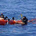 Search And Rescue Swimmers Retrieve by Stocktrek Images