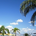 Seaside Bay Cafe Blue Sky And Sun Umbrellas In Nafplion Greece by John Shiron