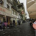 Seated In The Cafe Along The River In Lucerne In Switzerland by Ashish Agarwal