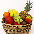 Selection Of Tempting Fresh Fruits In A Basket by Rosemary Calvert
