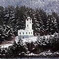 Sentinel Island Lighthouse In The Snow by Myrna Bradshaw