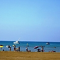 Sexy Peniscola Beach And Mediterranean Sea Boats And Umbrellas In Spain by John Shiron