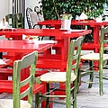 Sidewalk Cafe Red Table Green Chair Set Up In Nafplion Greece by John Shiron
