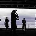 Silhouette Of Sailors In The Hangar Bay by Stocktrek Images