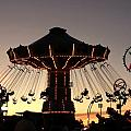 Silhouetted Amusement Ride by Kim French