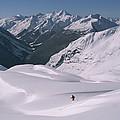 Skier Phil Atkinson Heads Down Mount by Tim Laman