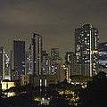 Skyline Of Singapore At Night As Seen From An Apartment Complex by Ashish Agarwal